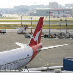 Qantas Airways books net loss, scraps order for 35 B-787 Dreamliners