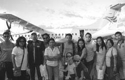 "Photo shows (standing from left) Edwin Sarmiento, Luz Caliwag (VP Sales and Operation), Richard Uy (Import Supervisor), Mark Fabrero, Arlene Crisologo, Oscar Tinegra, (girls sitting in front) Nympha Zaldua, Cheryl Gimena Jonaliza Balacuit (General Manager), Niño Alan Bamba, Ivy Migullas, Mercy Castillo (VP Accounts and Admin), and Ramcel ""Bong"" Temeña (Operations Manager)."