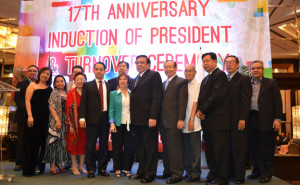 The Port Users Confederation recently celebrated its 17th anniversary which coincided with induction of its new president Col. Rodolfo De Ocampo, who took over from Dominador de Guzman. At the event were directors (L to R) Atty. Reynaldo Dizon, Marivic Briones, Jennifer Bote, Atty Oscar Sevilla (partly hidden), Noemi Saludo, Bureau of Customs deputy commissioner for Enforcement Group Ariel Nepomuceno, Julita Lopez, Fred Mozo (behind Lopez), Col. De Ocampo, Virgilio Veneracion, Atty Clemente San Agustin, De Guzman (immediate past president), Bobby Yatco and Eduardo De Guzman. Other photo shows turnover of PUC flag from De Guzman to De Ocampo.