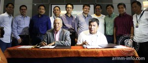 Customs Commissioner Alberto Lina (seated left) and Autonomous Region of Muslim Mindano (ARMM) regional governor Mujiv Sabbihi Hataman sign the joint memorandum order on the mandatory electronic processing of transshipments in Regional Economic Zone Authority areas. With them are, among others, BOC deputy commissioner for Assessment and Operations Atty Agaton Uvero (standing second from left) and deputy commissioner for Revenue Collection and Monitoring Atty Arturo Lachica (third from left). Photo courtesy of ARMM.