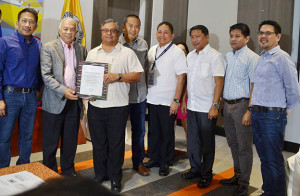 Davao International Container Terminal (DICT) and Terminal Facilities Services Corp became the first two facilities in the country to secure accreditation as authorized customs facilities. Photo shows Alexander Valoria (third from right), president and CEO of Anflo Management and Investment Corp., owner of DICT, receiving DICT's accreditation from Customs commissioner Alberto Lina. With them are Customs deputy commissioner for Revenue Collection Monitoring Group Atty Arturo Lachica (leftmost); Anflocor vice president-Industrial Group Jesse Chiongson (fourth from left), San Vicente Terminal and Brokerage Services, Inc. senior assistant vice president Bonifacio Licayan (sixth from left); Anflocor assistant vice president-management Services Group Giovanni Pimentel (seventh from left); and Customs deputy commissioner for Assessment and Operations Atty Agaton Uvero (rightmost).